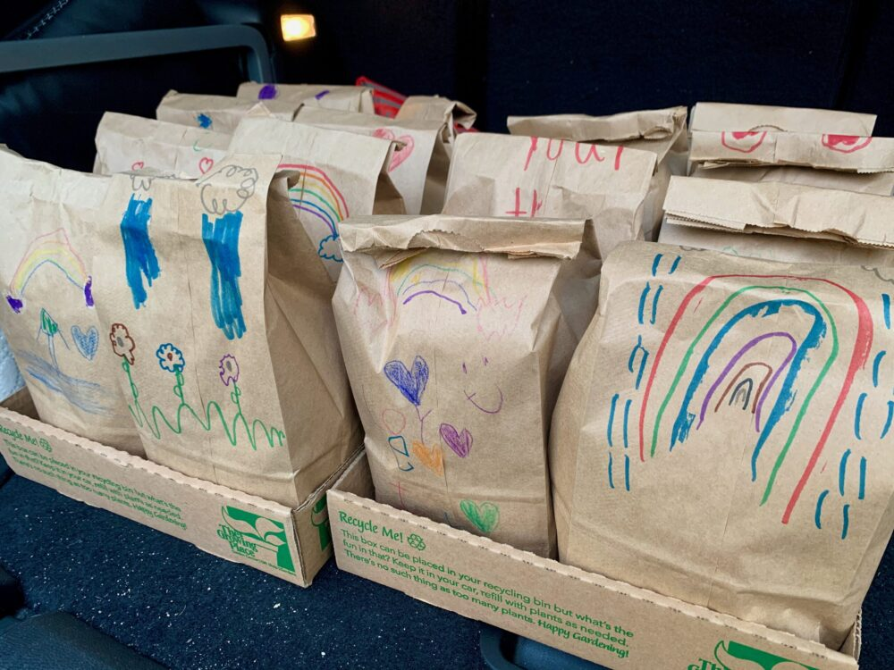 Children's drawing on lunch bags for local shelter - Raise kids who give back