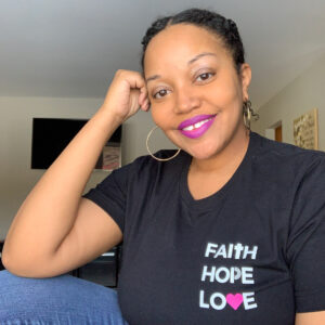kb wearing faith hope love t-shirt from love Maaden shop. one of my February favorite products