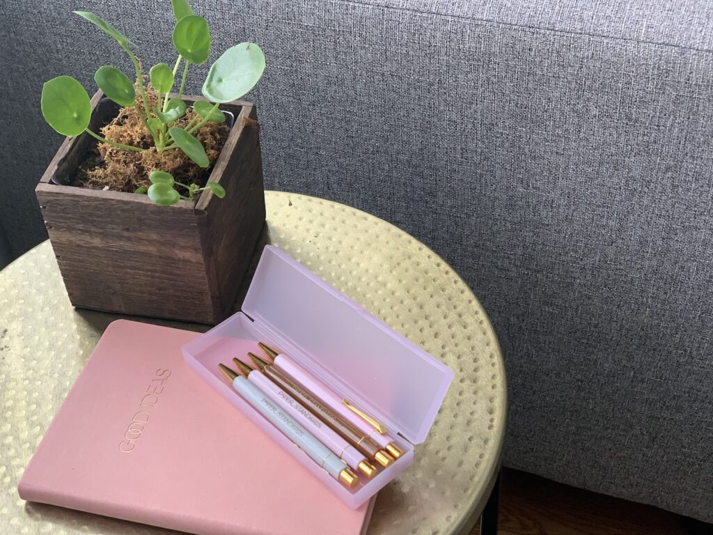 Pink leather notebook and pens from black-owned stationery brand named Paper Standards