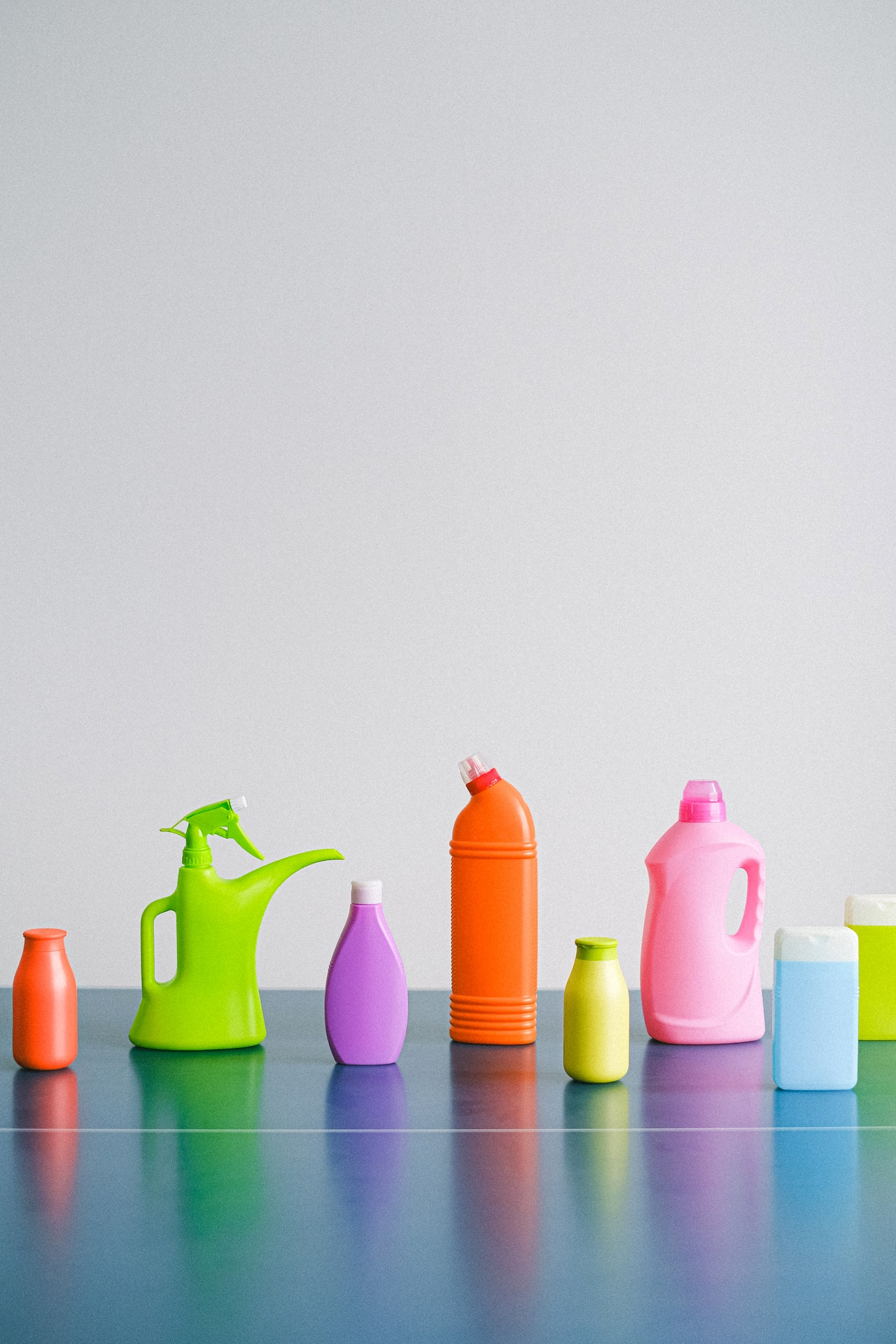 brightly colored laundry and cleaning product bottles to donate to food pantry