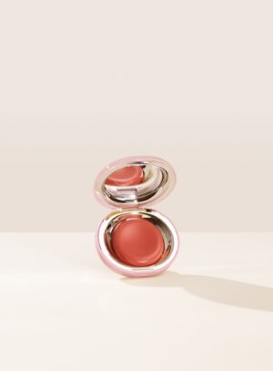 Rare Beauty apricot-colored melting blush in mirrored compact