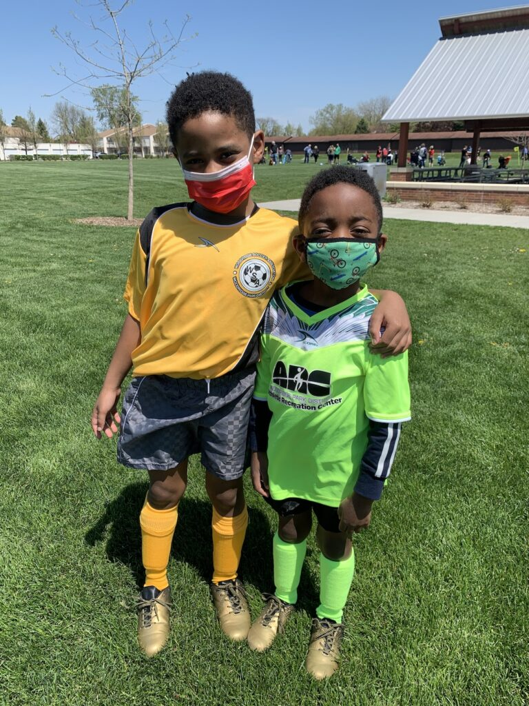 CLL boys in yellow soccer uniform (left) and green soccer uniform (right)