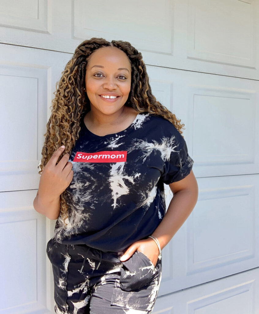 Woman smiling wearing Supermom Culture Black tie dye short set