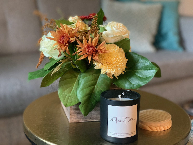 Fall bouquet from Flowers for Dreams and Bright Endeavors candle on a gold table. Simple hostess gifts supporting charities.